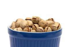 Pistachios bowl Stock Photos