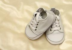 delicate baby shoes - stock photo