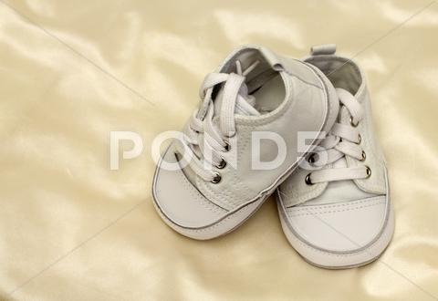 Stock photo of delicate baby shoes