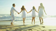 Happy Caucasian Family Walking Outdoors Wet Sand on Beach - stock footage