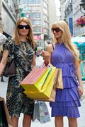 attractive shopping women  - stock photo