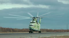 The military transport Mi-26 helicopter strongly runs up and easily flies up Stock Footage