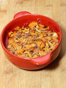 yellow mushrooms in red bowl - stock photo