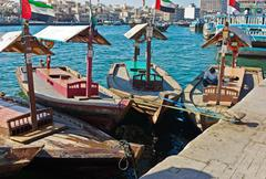 Traditional abra ferries at the creek in dubai, united arab emirates Stock Photos