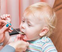 Feeding a young child Stock Photos