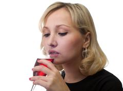 The girl drinks wine. Stock Photos