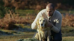 A man and his dog spending time together outdoors Stock Footage
