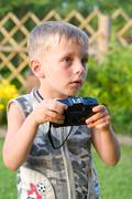 The boy with the camera. Stock Photos