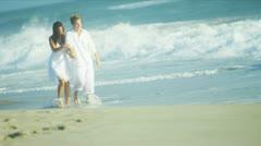Beach Couple Splashing in Ocean Shallows - stock footage