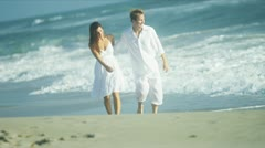 Attractive Couple Enjoying Time Walking Beach - stock footage