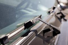 Wipers on car windows Stock Photos