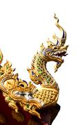 Naga on thai temple roof in the northern of thailand with isolate white backg Stock Photos