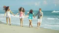 Family Enjoying Time Walking Beach Stock Footage
