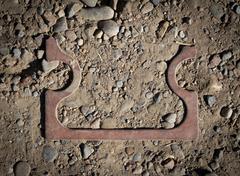 copper parts amid rubble - stock photo