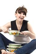 The mad housewife with saucepan. funny picture - stock photo