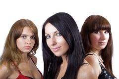 Portrait of three beautiful young women. Focus on the central gi - stock photo