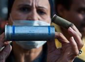 Woman in tahrir square and USA Made Tear Gas Stock Photos