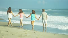 Parents Teenage Daughters Walking Linked Hands Beach - stock footage