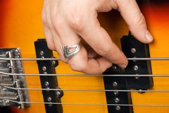 Hand of the guitarist on guitar strings Stock Photos