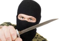 Portrait of the killer with a knife Stock Photos