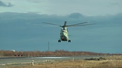 Military helicopter pilots learn to operate the big MI-26 helicopter Stock Footage
