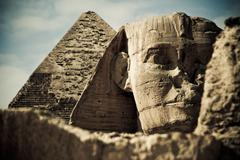 Pyramid and sphinx - stock photo