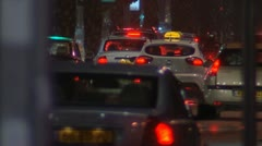 tail lights of cars and taxi's in heavy rain on the streets of Tel Aviv - stock footage