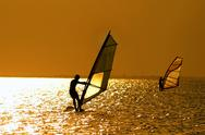 Stock Photo of Two windsurfers