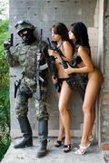 soldier and two women - stock photo