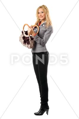 Stock photo of Smiling pretty blonde with a handbag. Isolated