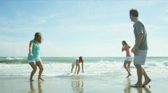 Parents Teenage Daughters Playing Ocean Shallows Stock Footage