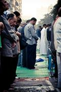 crowds are praying on the street of Cairo - stock photo