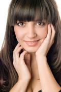 Young woman with dark hair and brown eyes Stock Photos