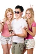 Two cheerful blonde woman and young man Stock Photos