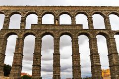 roman aqueduct in segovia (spain) - stock photo