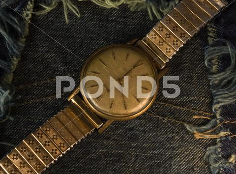 Stock photo of vintage golden wristwatch.