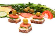 Stock Illustration of light and tasty snack of bread, cheese, smoked salmon and olives. with a dept