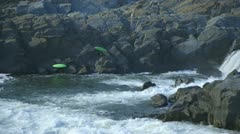 kyakers climbing out of the rapids - stock footage