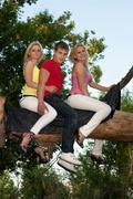 Two beautiful blonde and young man Stock Photos