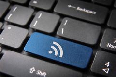 blue keyboard key rss icon, internet technology background - stock photo
