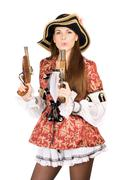 pretty woman with guns dressed as pirates - stock photo