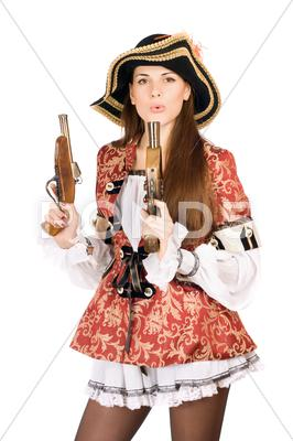 Stock photo of pretty woman with guns dressed as pirates