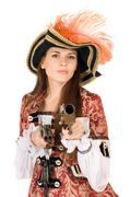 Charming young woman with guns - stock photo