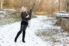Beautiful young woman with a gun Stock Photos