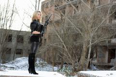 Young sexy woman with a gun Stock Photos