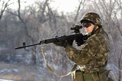 Soldier with a sniper rifle Stock Photos
