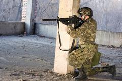 Armed man aiming Stock Photos