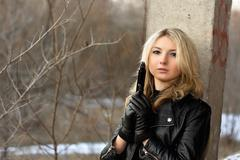 Sensual young woman holding a weapon Stock Photos