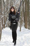Girl with gun on a frash air Stock Photos
