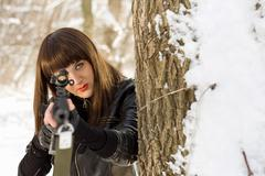 Young woman with a sniper rifle Stock Photos
